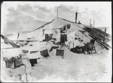 Scott, R F Antarctic , October 1911. Photographs like this one of the hut at Cape Evans provide a valuable record today, but were taken by Scott principally to practice using lenses, filters and other equipment.