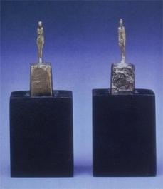 Alberto Giacometti; Two Figurines; 1945; metal, gold leaf