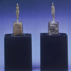 Alberto Giacometti; Two Figurines; 1945; metal, gold leaf