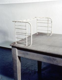 Doris Salcedo; Unland, irreversible witness; 1995-8; wood, cloth, metal, and hair; 44 x 98 x 35 inches