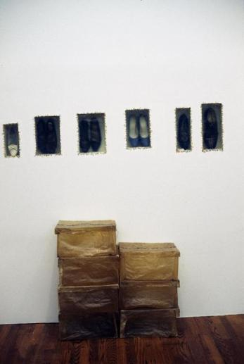 Doris Salcedo; Atrabiliarios; 1993; wall installation with plywood, nine shoes, cow bladder and surgical thread in six inches