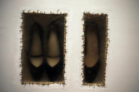 Doris Salcedo; Atrabiliarios; 1992-3; three shoes, plywood, cow bladder and surgical thread; 11.5 x 13.5 inches