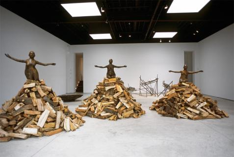 "Kiki Smith; Pyre Woman Kneeling, Pyre Woman on Haunches, Pyre Woman with Knees Extended; 2002; bronze and wood; left to right: 37"" x 61"" x 33"", figure 91"" x 124"" diameter with base dimensions variable; 37"" x 62 1/2"" x 28"", 100"" x 124"" diameter with base dimensions variable; 2"" x 39"" x 35"", 119"" x 124"" diameter with base dimensions variable"