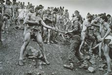 Sebastiao Salgado; Brazil: Dispute among the workers of the Serra Pelada gold min and military police; 1986