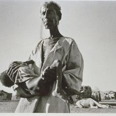 Sebastiao Salgado; Sudan: refugees arriving from Eritrea to Wad Sheifray camp; 1985