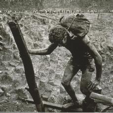 Sebastiao Salgado; Brazil: Transporting bags of dirt in the Serra Pelada gold mine; 1986