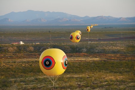 """Repellent Fence_Valla Repelente,"" 2015, Land art installation and community engagement (earth, cinder block, para-cord, PVC spheres, helium). Aerial view, US_Mexico Border, Douglas, Arizona _ Agua Prieta, Sonora."